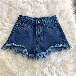 High waisted fringe jean shorts